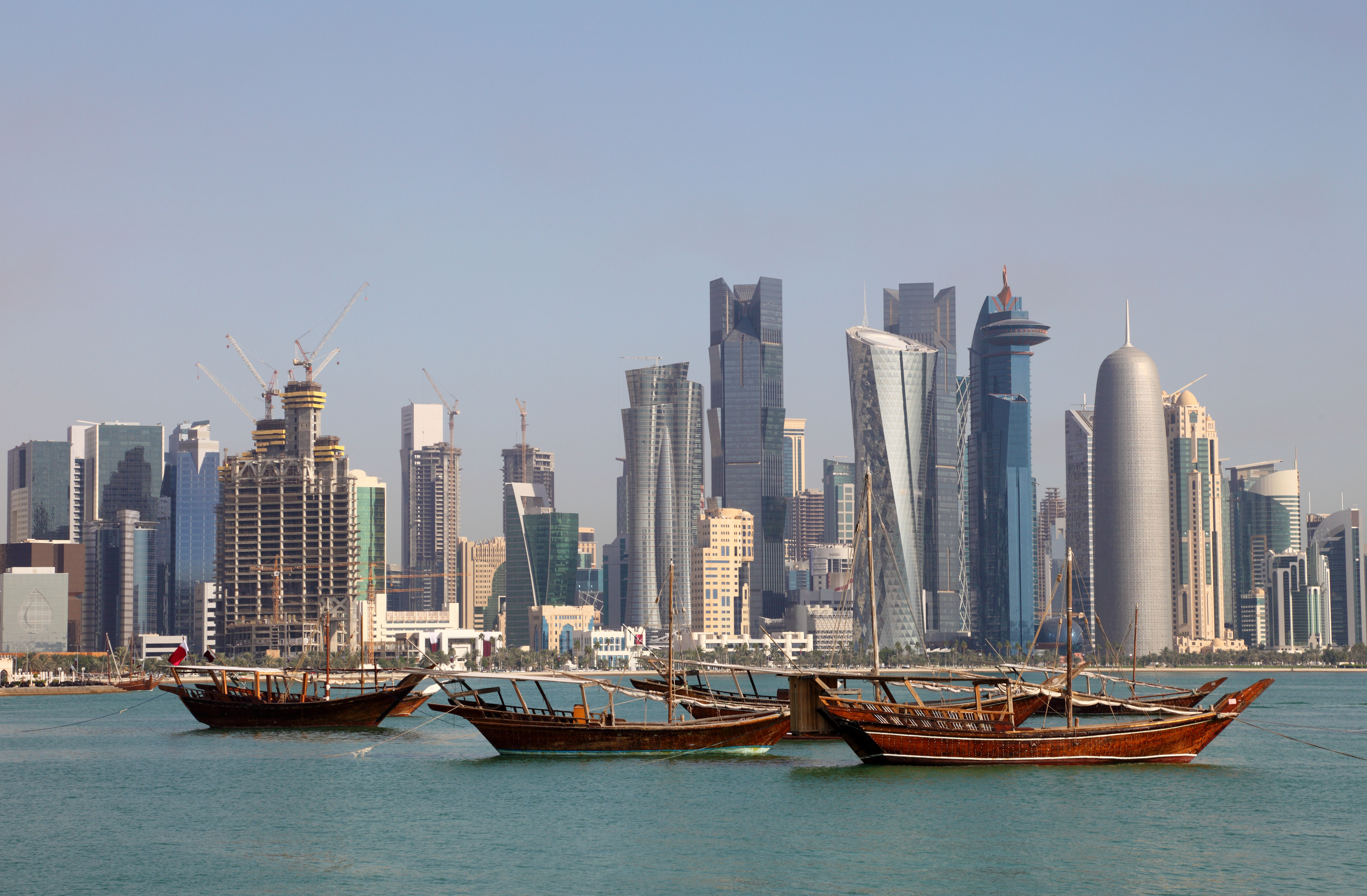 Skyline of Doha with traditional arabic dhows. Qatar, Middle East. Source: philipus/Fotolia