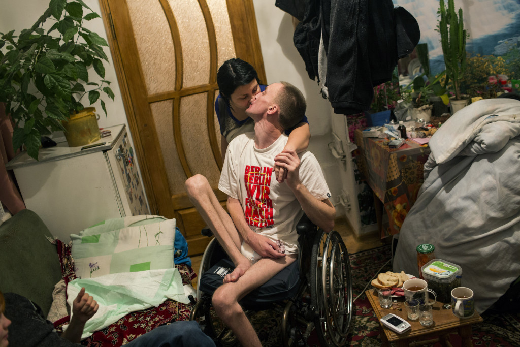 "Volodymyr Honcharovsky, 31, a married father of four children, kisses his wife, Oksana, in their home in Teofipol, Ukraine, Nov. 17, 2014. He was severely wounded on Feb. 20, 2014, when he was shot three timesÑtwice in the back, once in the right armÑwhile attempting to reach wounded demonstrators who had been shot by security forces during the Euromaidan revolution in Kiev. ÒLife for us is very difficult at the moment,"" said Oksana Khivchuk, his wife. We hoped that he would slowly begin to walk again, but as you see, there have been no changes."""