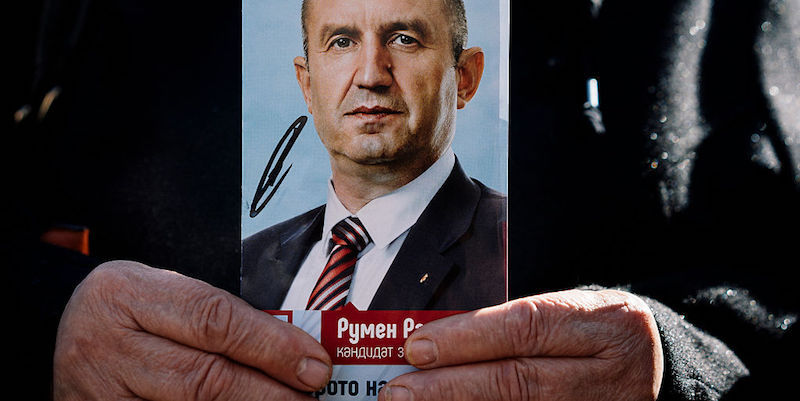 A supporter of Bulgarian Socialist party holds a picture of former head of the Bulgarian airforce Rumen Radev, candidate of the opposition Socialists during a pre-election rally in the town of Byala Slatina on November 2, 2016. Bulgarians vote PN November 6 in the first round of presidential elections expected to set up a close runoff between Prime Minister Boyko Borisov's right-hand-woman and a MiG-flying ex-general seen as sympathetic to Moscow. Graft and poverty remain rife, however, and Borisov has failed to implement much-needed reforms. A new concern is now also on voters' minds in recent months, namely the thousands of migrants stranded in Bulgaria. / AFP / DIMITAR DILKOFF (Photo credit should read DIMITAR DILKOFF/AFP/Getty Images)