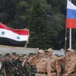Soldati russi marciano durante una prova della sfilata di Victory Day, svoltasi con un'unità siriana alla base aerea di Hmeimym nella provincia di Latakia, in Siria, il 4 maggio 2016. Credits to: Sergei Chirikov/EPA.