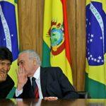 Il presidente boliviano Evo Morales (a sinistra) e il presidente brasiliano Michel Temer sono raffigurati durante la firma degli accordi a Planalto Palace, Brasilia, il 5 dicembre 2017. Credits to: Evaristo Sa/AFP/Getty Image.